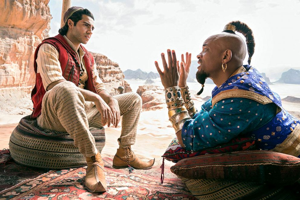 PHOTO: Mena Massoud, left, as Aladdin, and Will Smith, as Genie, in a scene from Aladdin.