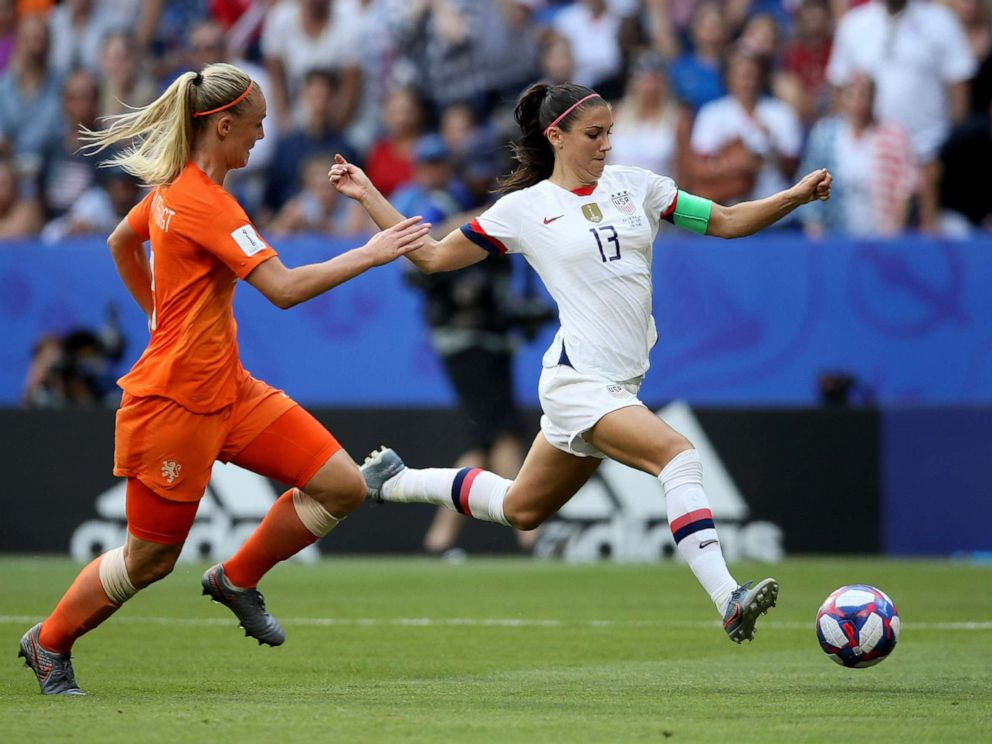 PHOTO: Alex Morgan, right, fights for the ball with Netherlands Stefanie Van Der Gragt during the Womens World Cup final soccer match between US and The Netherlands at the Stade de Lyon in Decines, outside Lyon, France, July 7, 2019.