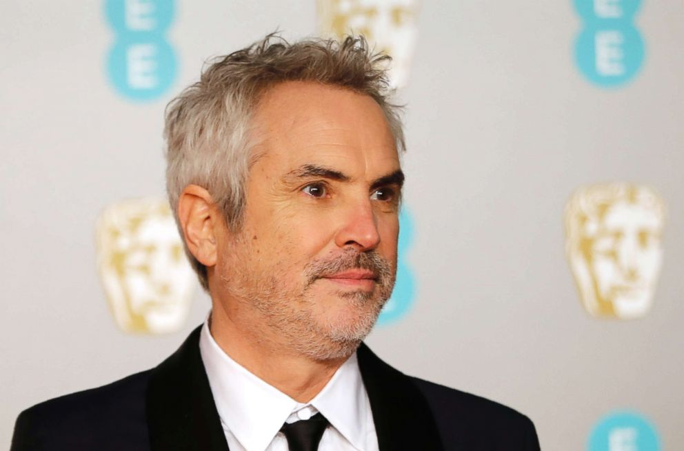 Alfonso Cuaron poses on the red carpet upon arrival at the British Academy Film Awards in London, Feb. 10, 2019.