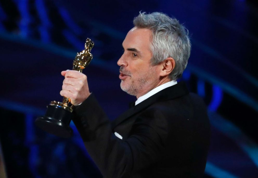 PHOTO: Director Alfonso Cuaron accepts the Best Cinematography award for Roma, at the Oscars, Feb. 24, 2019 in Los Angeles.