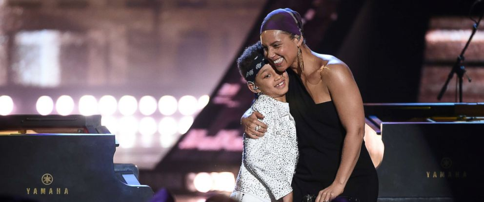 PHOTO: Alicia Keys performs on stage with son Egypt at the 2019 iHeartRadio Music Awards at the Microsoft Theater on March 14, 2019 in Los Angeles.