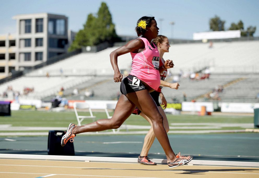 PHOTO: A pregnant Alysia Montano runs in the opening round of the womens 800 meter run during day 2 of the USATF Outdoor Championships at Hornet Stadium, June 26, 2014, in Sacramento, California.
