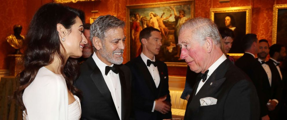 PHOTO: Amal Clooney and George Clooney speak to Prince Charles, Prince of Wales as they attend a dinner to celebrate The Princes Trust, hosted by Prince Charles, Prince of Wales at Buckingham Palace, March 12, 2019 in London.