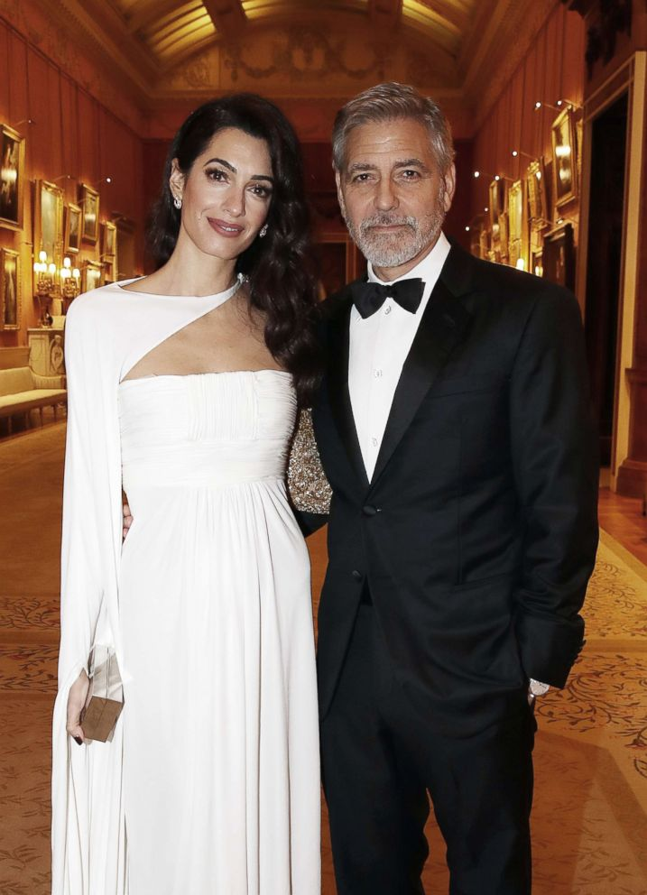 PHOTO: Amal Clooney and George Clooney attend a dinner to celebrate The Princes Trust, hosted by Prince Charles, Prince of Wales at Buckingham Palace, March 12, 2019, in London.