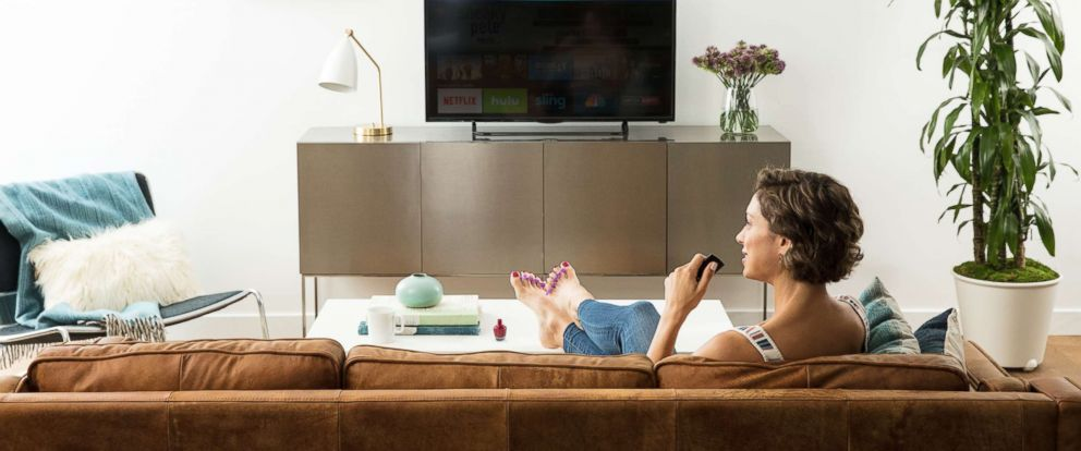 PHOTO: A woman uses an Amazon Fire TV in an undated marketing image from Amazon.