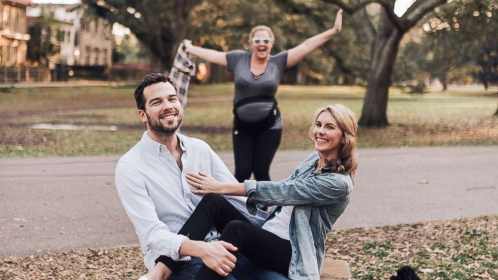 Katherine Salisbury and James Matthews posed in an engagement shoot in New Orleans, where actress Amy Schumer photobombed the couple.