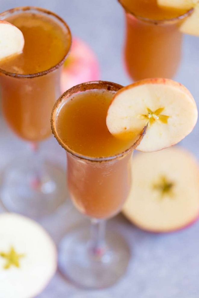 PHOTO: Rim the glasses of your apple cider mimosas in cinnamon sugar and garnish with apple slices.
