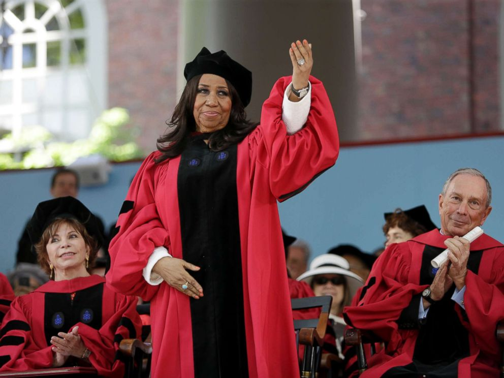 PHOTO: Aretha Franklin waves as she receives an honorary Doctor of Arts degree during Harvard commencement ceremonies in Cambridge, Mass, May 29, 2014.