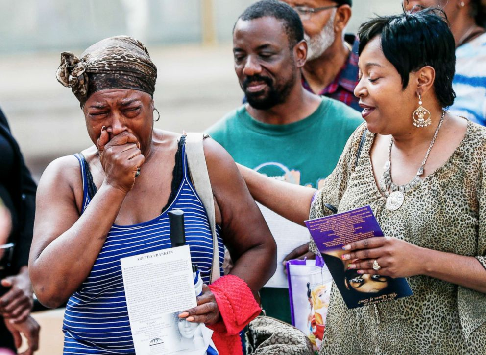 PHOTO: A woman cries as she watches the open coffin of the body of Aretha Franklin on a public visit to the Charles H. Wright Museum of African American History in Detroit, August 28, 2018.