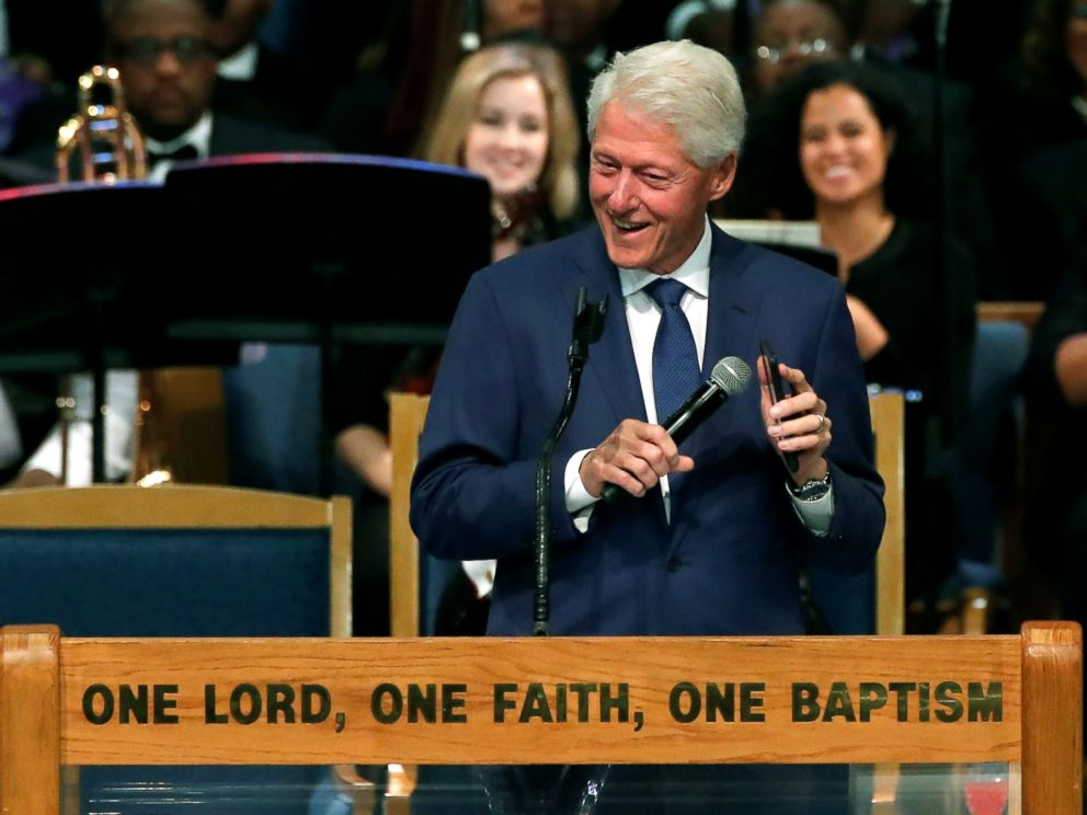PHOTO: Former President Bill Clinton plays Aretha Franklin music on his mobile phone while speaking at the funeral service for the late singer at the Greater Grace Temple in Detroit, Aug. 31, 2018.