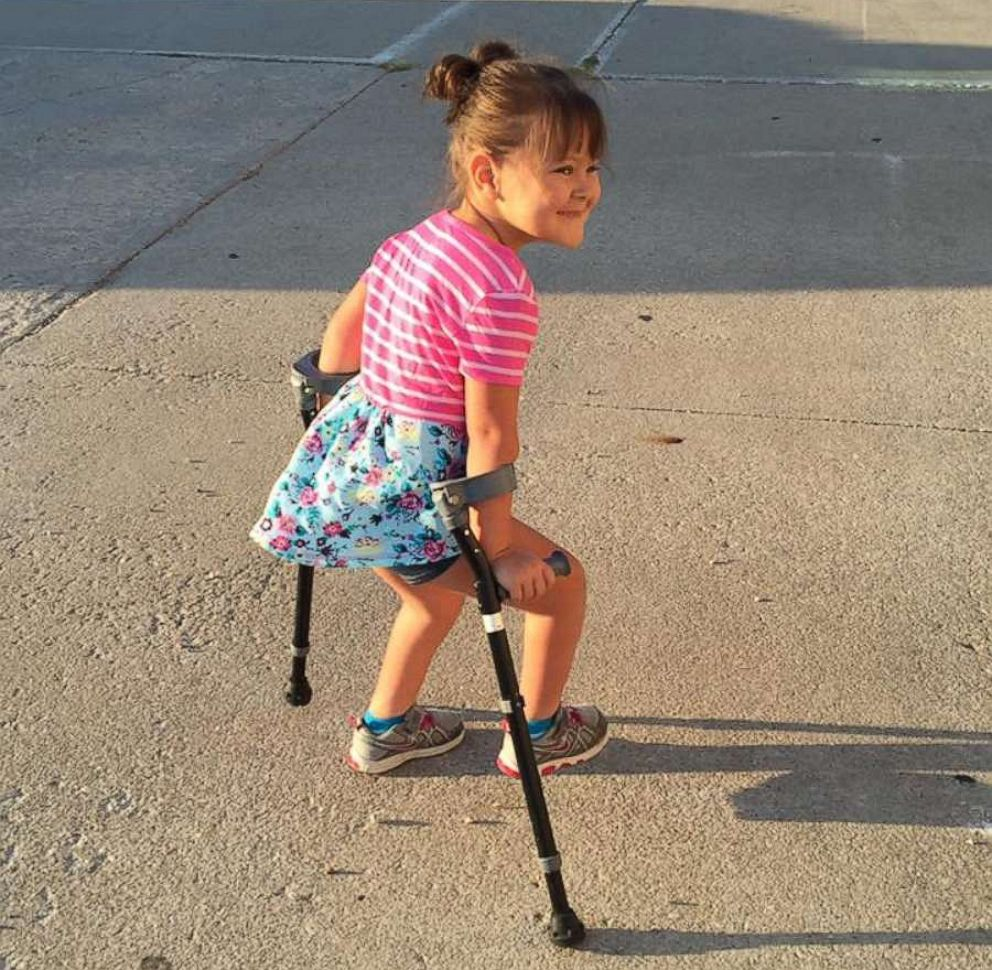 PHOTO: Aubrey transitioned from a wheelchair to crutches, before she was eventually able to walk on her own.