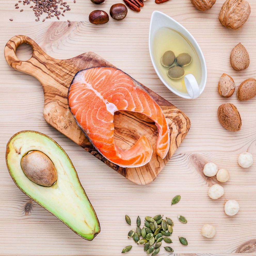 PHOTO: A selection of food sources of Omega-3 and unsaturated fats including various nuts, olive oil, salmon and avocado are pictured in this undated stock photo.