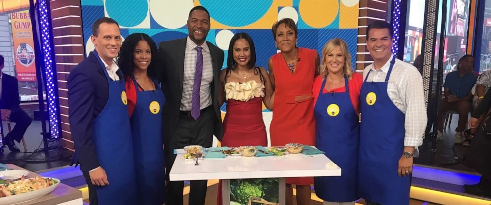 "PHOTO: ""Family Food Fight"" host Ayesha Curry, center, appears on ""Good Morning America,"" June 18, 2019."