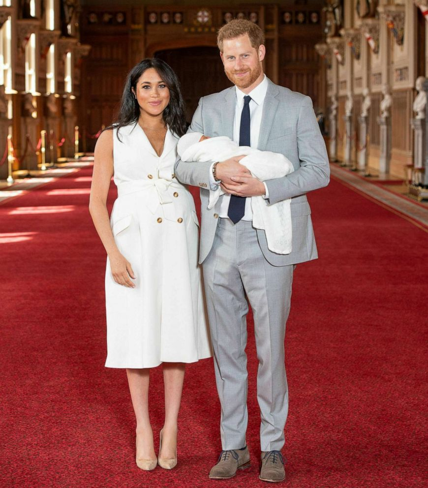PHOTO: Prince Harry and Meghan, Duchess of Sussex, pose for photographers with their newborn son, in St Georges Hall at Windsor Castle, Windsor, England, May 8, 2019.