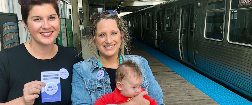 PHOTO: Colleen Curtis, left, and Megan Nufer with her three-month-old daughter Charlotte at the CTA's Merchandise Mart stop Wednesday. Both young mothers are wearing Baby on Board buttons made by The Mom Project.