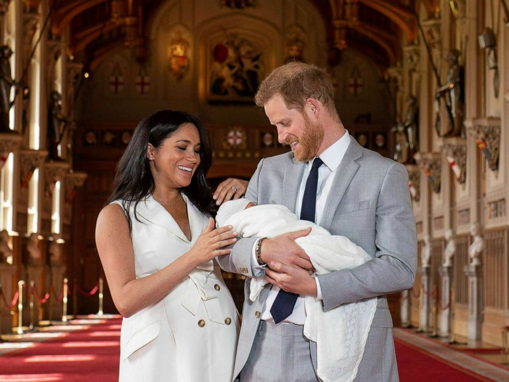 PHOTO: Britains Prince Harry and Meghan, Duchess of Sussex, hold their newborn son, in St. Georges Hall at Windsor Castle, Windsor, England, May 8, 2019.