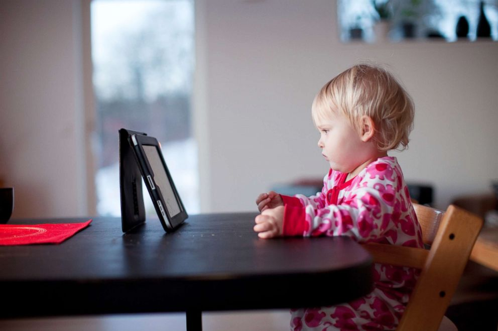 PHOTO: A baby looks at a digital tablet in this undated stock photo.