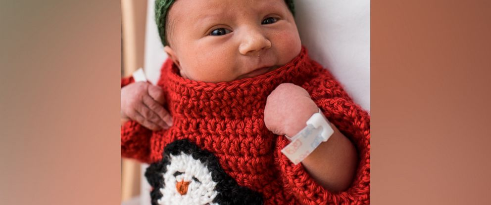 PHOTO: A newborn baby in University Pittsburgh Medical Center Magee-Womens Hospital is dressed in an ugly Christmas sweater with a penguin embroidery.