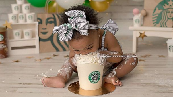 This baby dives right into her Starbucks in adorable photo shoot