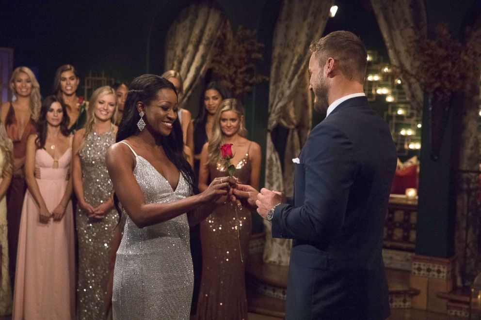 "Colton Underwood hands a rose to Onyeka on ""The Bachelor,"" on ABC, Jan. 7, 2018."