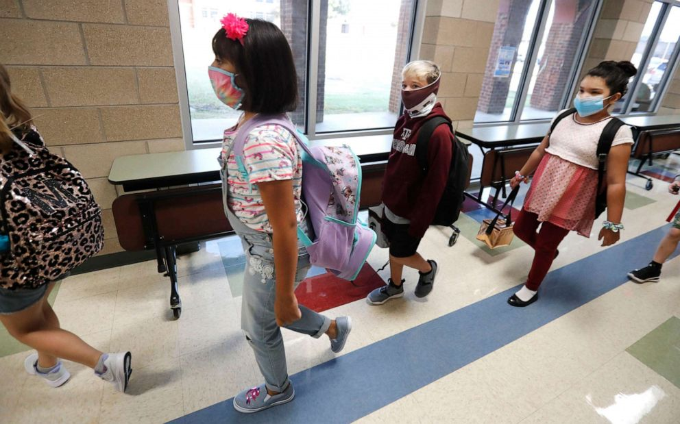 PHOTO: Students wearing masks to prevent the spread of COVID19 walking to class to begin their school day in Godley, Texas, Aug. 5, 2020.