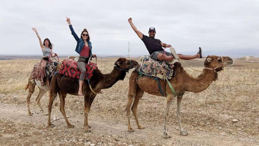 PHOTO: Bailey Matheson, center, rides a camel in Morocco with her boyfriend Brent Andrews and her friend Julie Carrigan.
