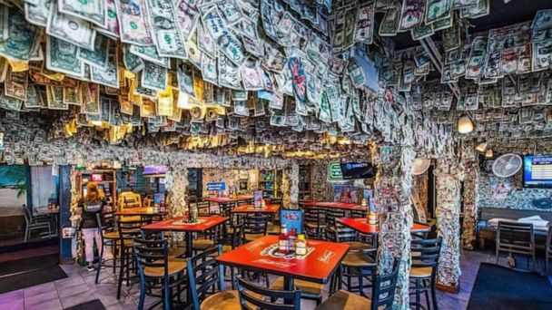 Staff at Florida bar pulls $14,000 off walls to donate to Hurricane Dorian relief