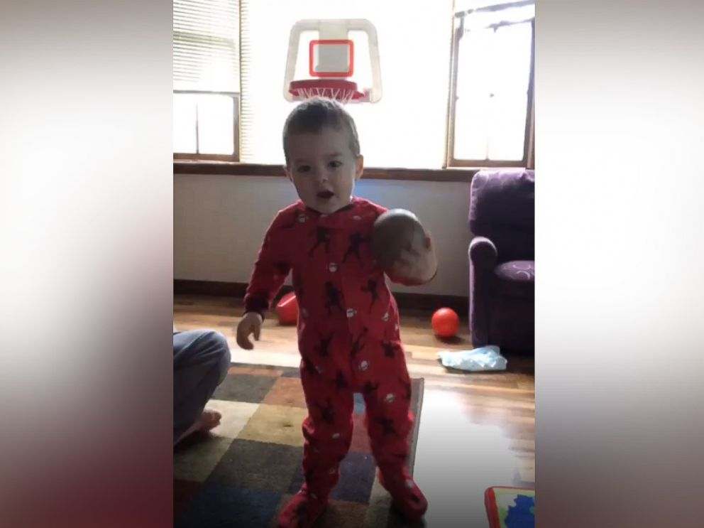 PHOTO: On five impressive occasions thus far, Elijah Bender, 2, has been caught on camera by his mother while shooting a basketball into a hoop without actually looking at the basket.