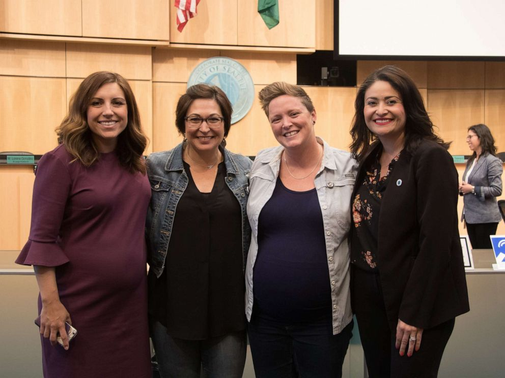 PHOTO: From left to right, Seattle Council Member Teresa Mosqueda, Erin Alder, Rachel Alder and Seattle Council Member Lorena Gonzalez pose on June, 3, 2019.