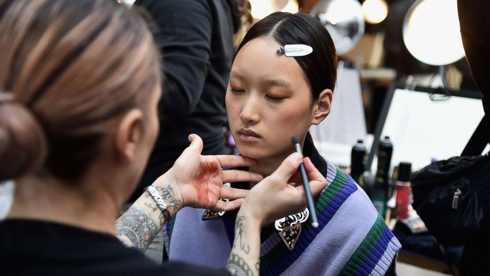 A model prepares backstage for a fashion show during New York Fashion Week, Feb. 8, 2019, in New York.