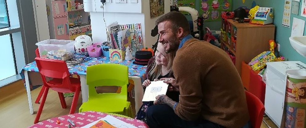 PHOTO: David Beckham recently surprised a young fan in a hospital in London. Beckham told Ella Chadwick that she was the winner of the Child of Courage award.