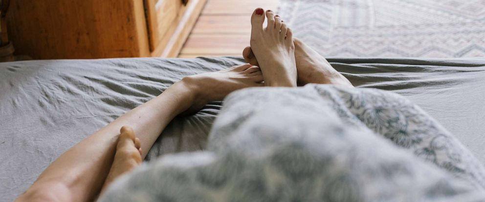 PHOTO: A couple lies in bed in this stock photo.