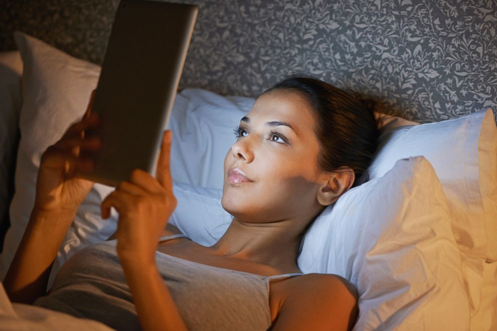 PHOTO: A woman reads before bed in this undated stock photo.