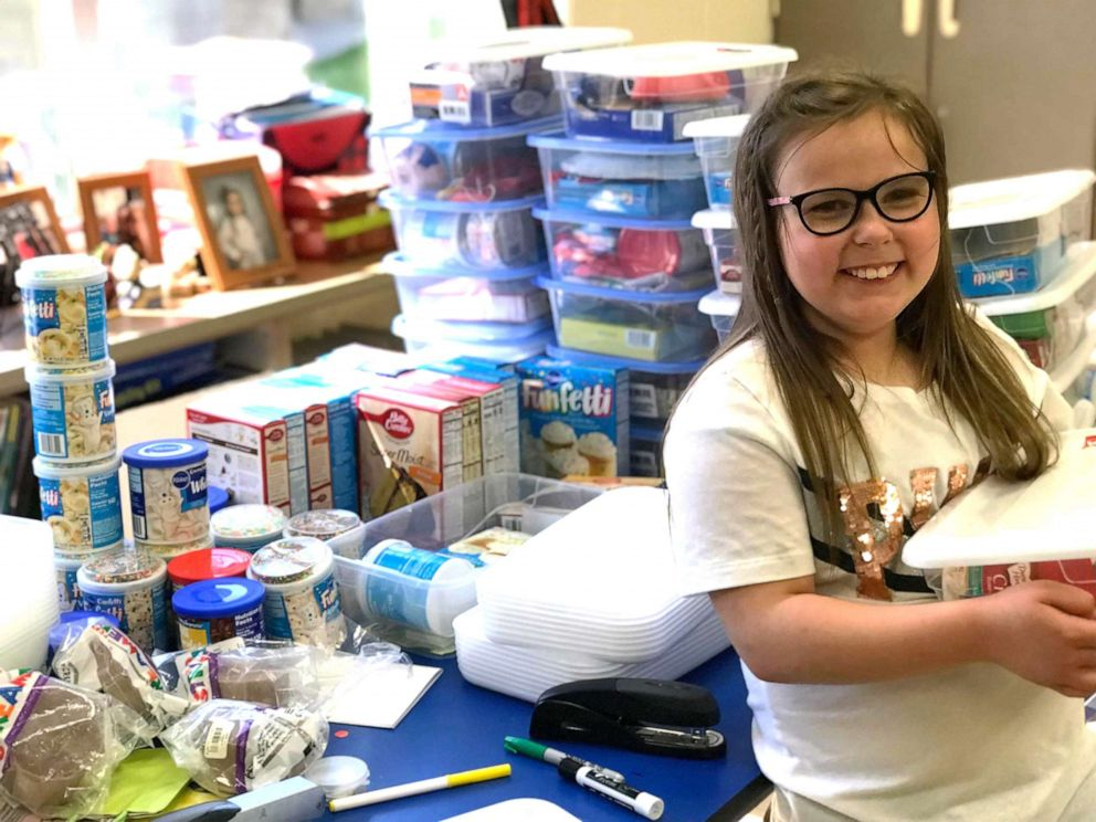 PHOTO: Bella Smith, 9, a third grade students at Wyan-Pine Grove Elementary School in Kentucky, packs boxes with balloons, cake mix and other party supplies for her less fortunate classmates.