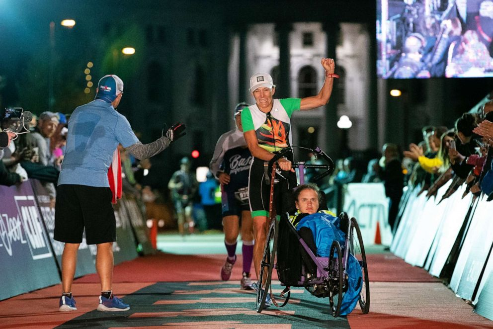 PHOTO: Beth James and Liza James finish the IRONMAN Wisconsin, Sept. 9, 2018, in Madison, Wisconsin.