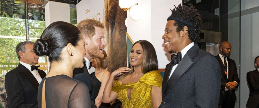 "PHOTO:Meghan, Duchess of Sussex and Prince Harry, Duke of Sussex meet cast and crew, including Beyonce Knowles-Carter and Jay-Z as they attend the European Premiere of Disneys ""The Lion King"" at Odeon Luxe Leicester Square on July 14, 2019 in London."