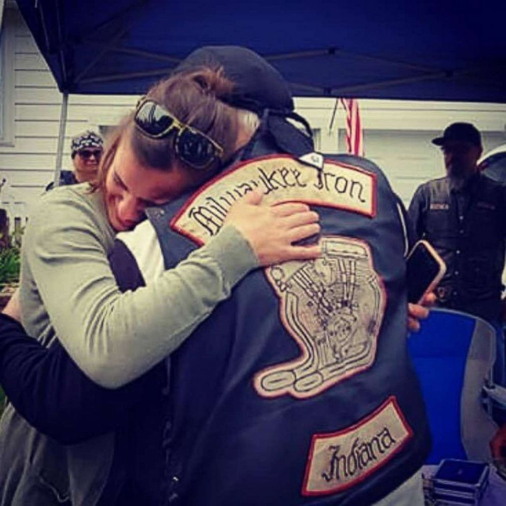 PHOTO: Daryn Sturch of Denver, Indiana, exchanges hugs with a member of the Milwaukee Iron motorcyle group, whom she helped after a motorcycle crash in 2018.