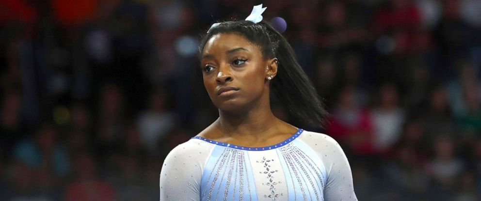 PHOTO: Simone Biles waits at the balance beam during qualifying sessions for the Gymnastics World Championships in Stuttgart, Germany, Oct. 5, 2019.