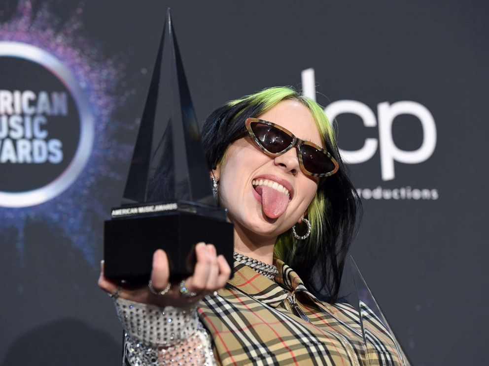 PHOTO: Billie Eilish poses in the press room with the award for new artist of the year and favorite alternative rock artist at the American Music Awards on Sunday, Nov. 24, 2019, at the Microsoft Theater in Los Angeles.