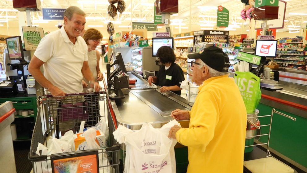 PHOTO: Bennie loves to chat with customers as he bags their groceries.