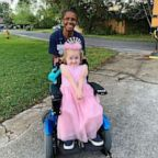 Arletha Sherman, 64, of Jacksonville, Fla., is pictured with pre-kindergartener Anna Hopson, 5, on April 10, 2019. Sherman decorated the school bus Anna rides  for her birthday.