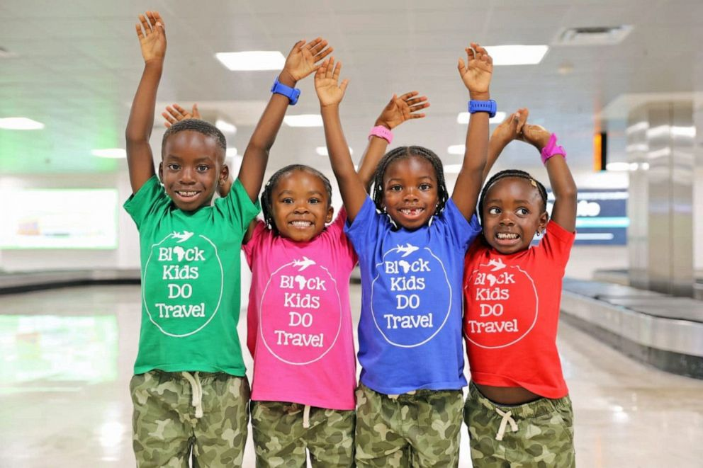 PHOTO: Kids pose at the airport in Black Kids DO Travel shirts.
