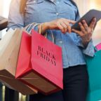 A woman is pictured holding shopping bags at the mall in this undated stock photo.