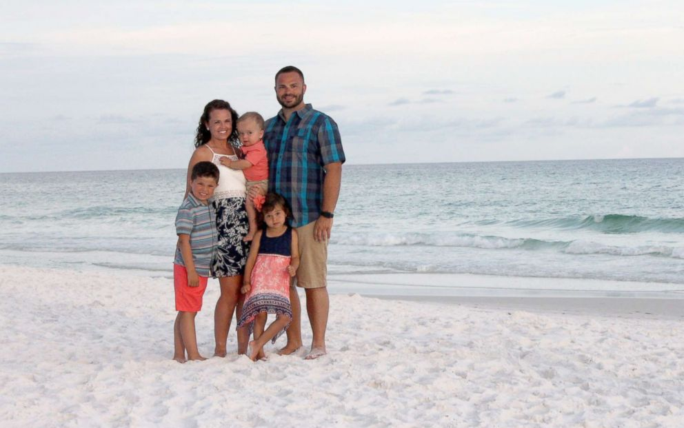 PHOTO: Adam and Whitney Dinkel of Overland Park, Kansas, seen in a photo while vacationing in Florida with their children, Layton, 6, Gracelyn, 4 and Roman, 2.