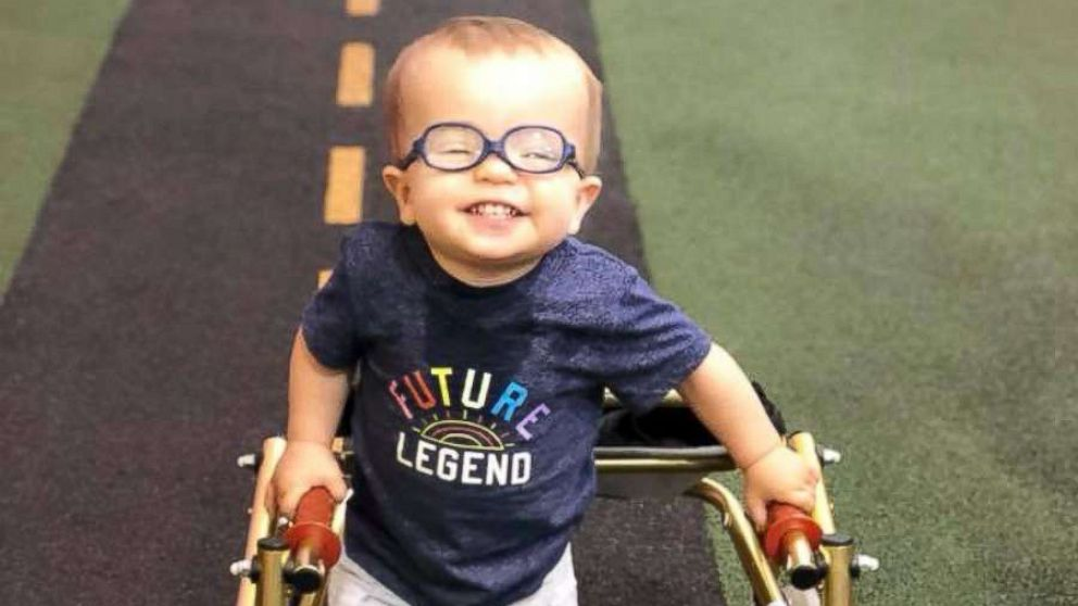 Toddler with spina bifida warms hearts after showing his dog he can walk