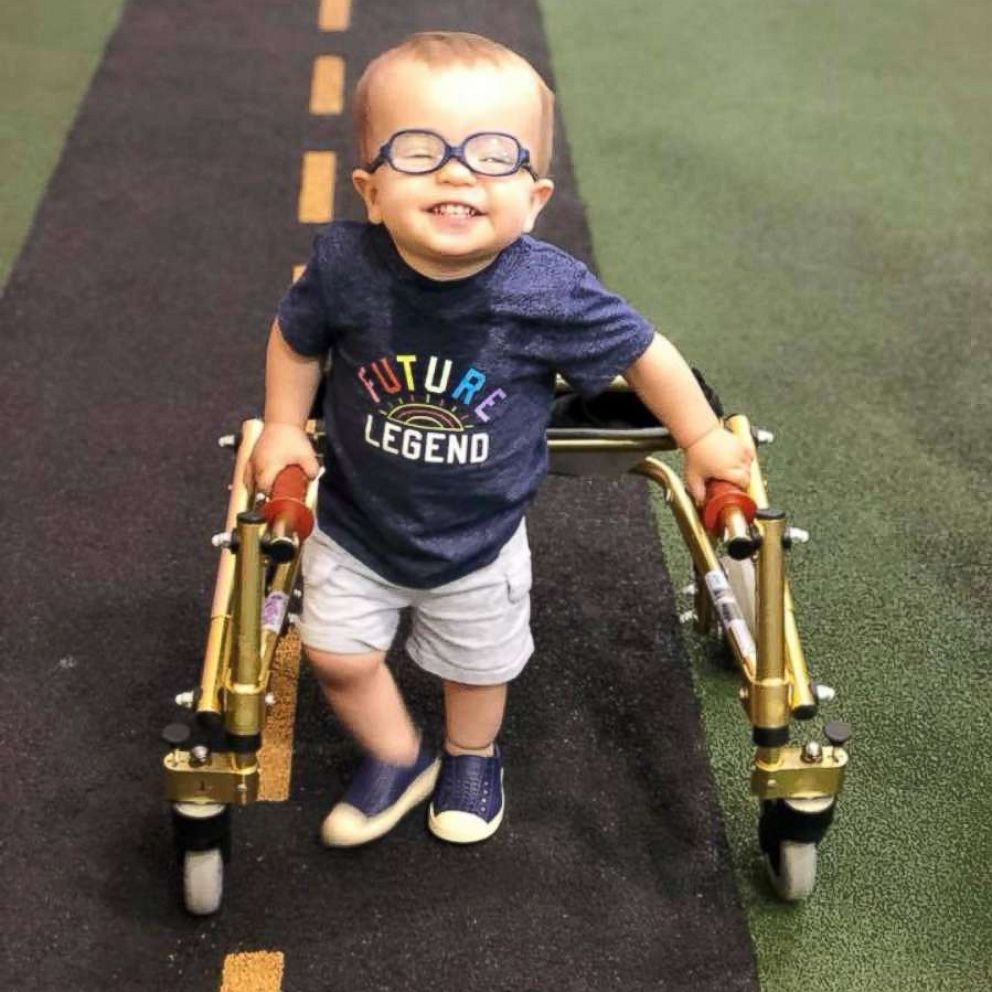Toddler with spina bifida warms hearts after showing his dog