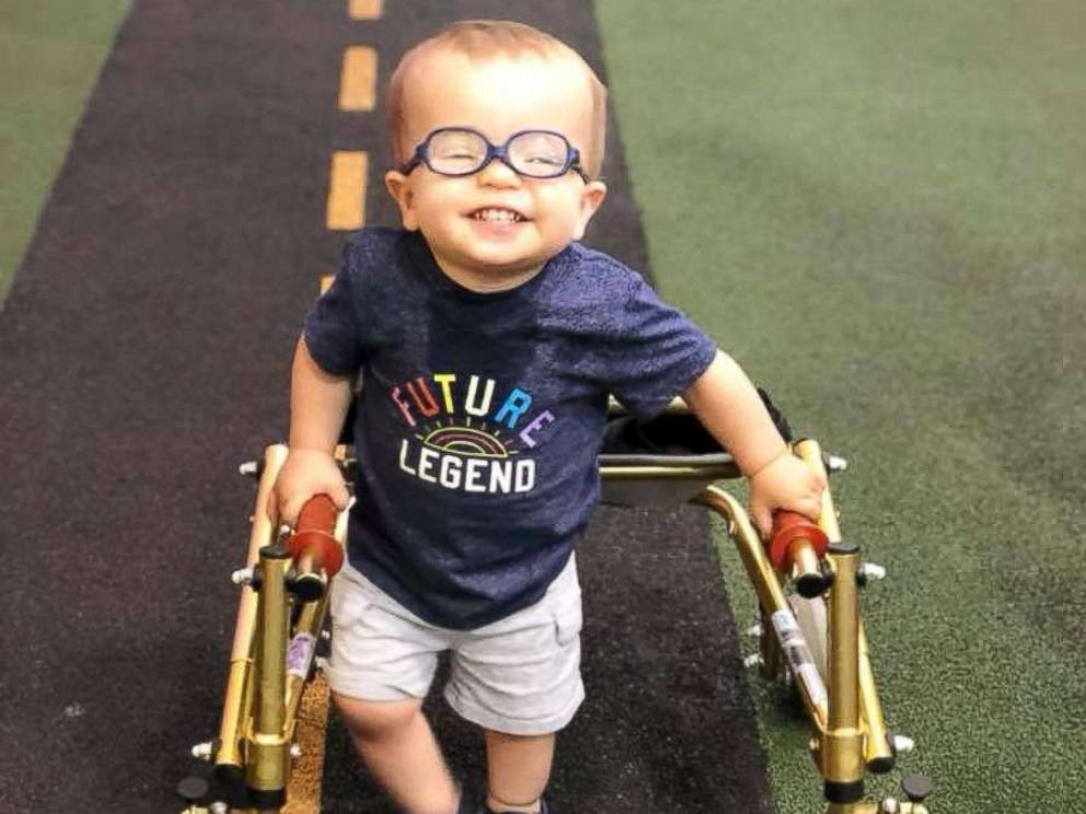 PHOTO: Roman Dinkel, 2, who was born with spina bifida, went viral after sharing the celebratory moment with his dog of him using crutches without assistance.