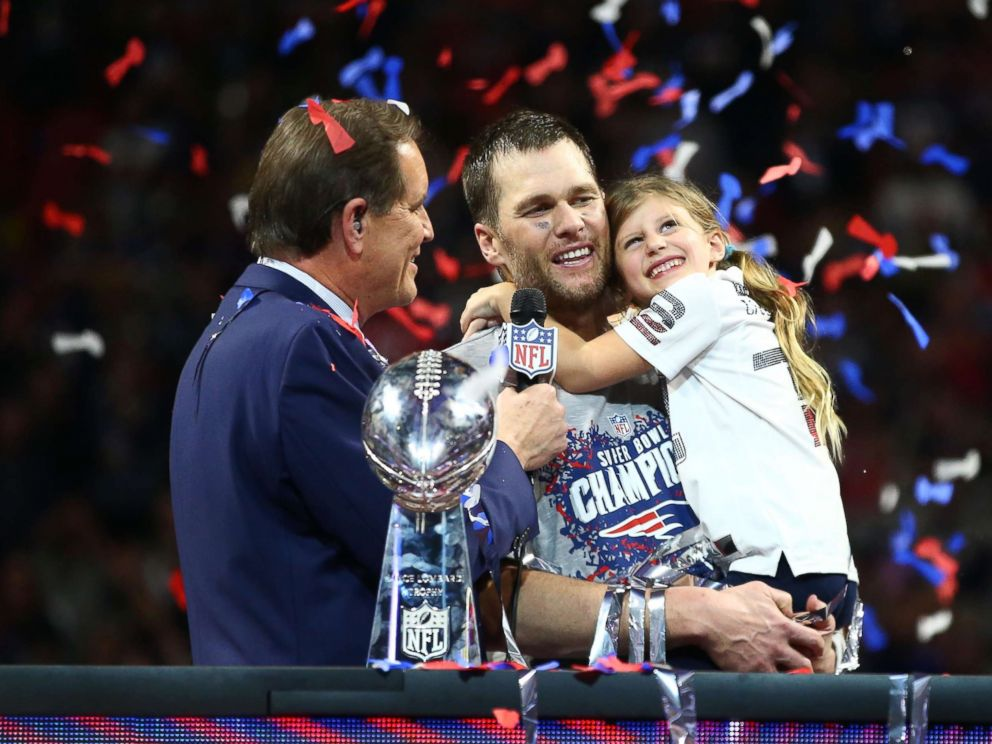 PHOTO: New England Patriots quarterback Tom Brady (12) and daughter Vivian celebrate as they are interviewed by CBS host Jim Nantz after Super Bowl LIII against the Los Angeles Rams at Mercedes-Benz Stadium in Atlanta, Feb 3, 2019.