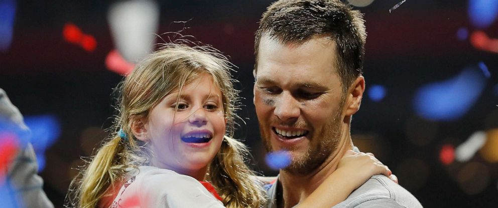 PHOTO: Tom Brady of the New England Patriots carries his daughter Vivian Lake Brady at the end of the Super Bowl LIII at Mercedes-Benz Stadium on Feb. 3, 2019 in Atlanta.