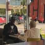 Two strangers were captured enjoying breakfast together after a woman asked Eric Haralson, 28, of Noblesville, Ind. if she could sit down and eat with him at a McDonald's located in Noblesville, Ind.